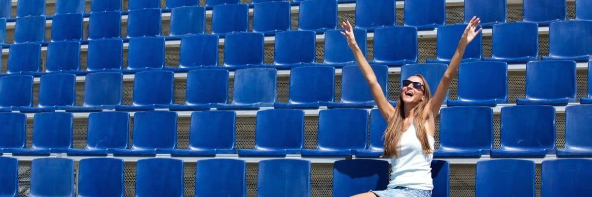 woman alone in the stands